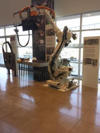 An example of a robotic arm used to help workers