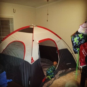 """The tent set up for the kids to """"camp"""" in."""