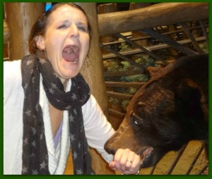 The bear is eating me!!!! No worries, this is me being silly and my mom happened to snap the picture just in time.