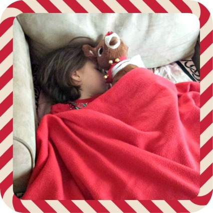 Elf zonked out on the couch. This is what happens when you are too excited and can't sleep at night.