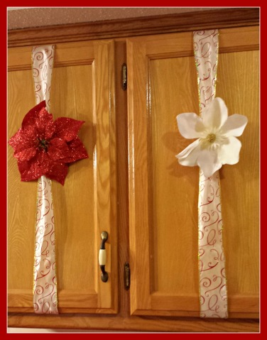 2 rolls of wired ribbon and 10 flowers with clips. I opted for the sparky red poinsettias and white magnolias